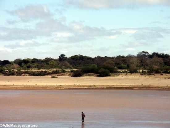 Antandroy man in river (Berenty)