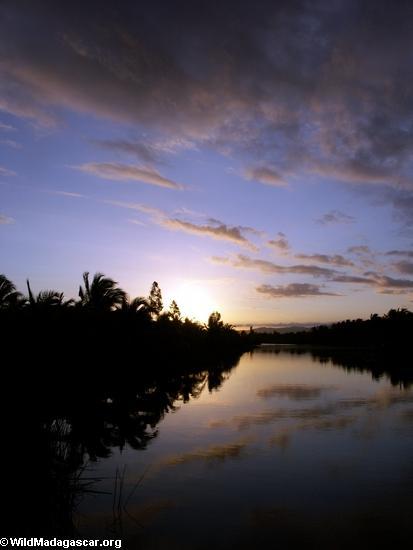 Sunset over a canal near Maroantsetra (Maroantsetra)