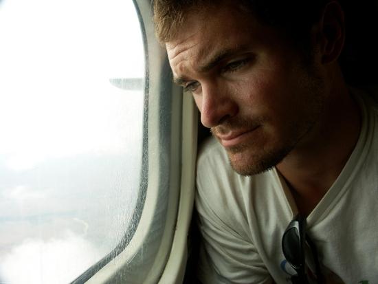 Rhett looking out plane window (Tulear) [moron_tulear226]