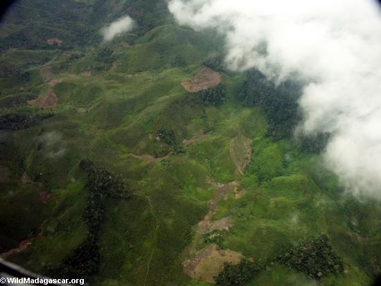 Aerial view of rainforest deforestation in Madagascar (Airplane flight from Anatananarivo to Maroantsetra)