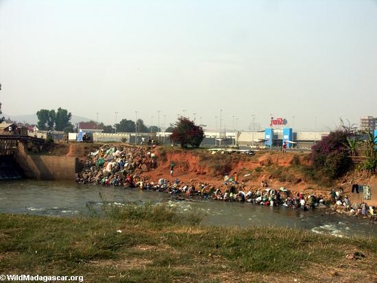 Residents of Tana doing laundry along river (Tana)