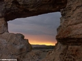 Sunset viewed through natural rock window in  Isalo National Park (Isalo)