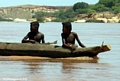 Sakalava boys with guitar in pirogue (Manambolo)