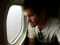 Man looking out plane window over Tulear