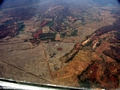 Aerial view of deforestation for rice cultivation in Madagascar (Airplane flight from Anatananarivo to Maroantsetra)